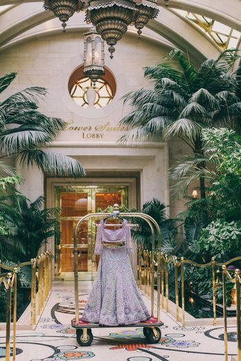Photo of Lavender bridal lehenga on clothesrack