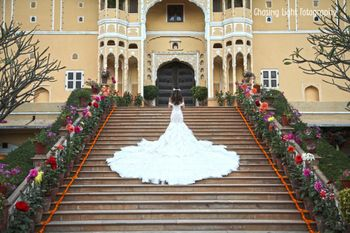 Bride in Ruffled White Wedding Gown with Dramatic Train