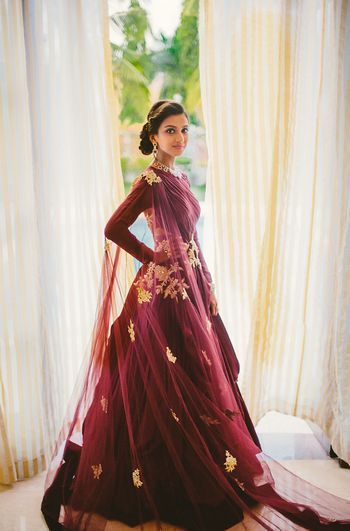 Marsala colored floor length sraped gown