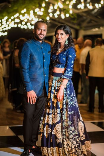 Photo of Dark blue and gold lehenga for sangeet or cocktail