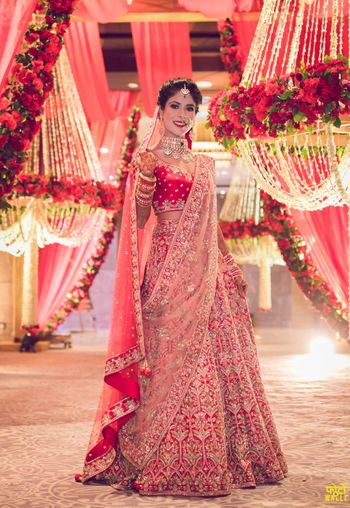 Photo of Red embellished bridal lehenga with pink dupatta