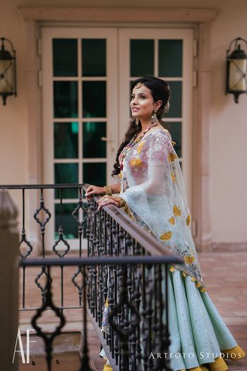Photo of Light blue lehenga for mehendi with mustard border