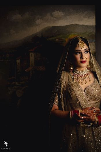 A bride in a gold lehenga for her wedding