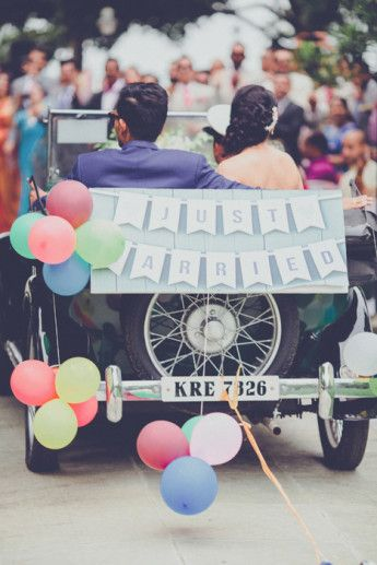 Photo of bride and groom leave in car