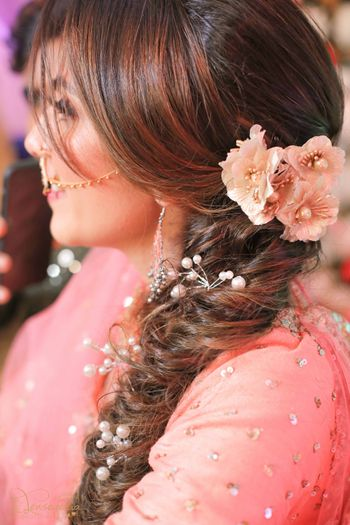 Bride wearing messy side braid.