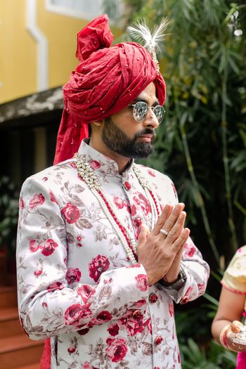 Unique groom look in floral sherwani and contrasting safa