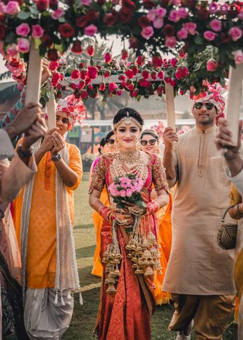 Photo of South indian bridal entry under phoolon ki chadar