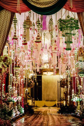 Unique entrance decor with flowers and lanterns