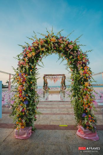 A floral archway decor with fresh flowers for a day wedding