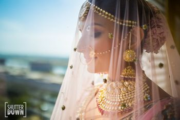 Photo of Bridal portrait idea with dupatta as veil