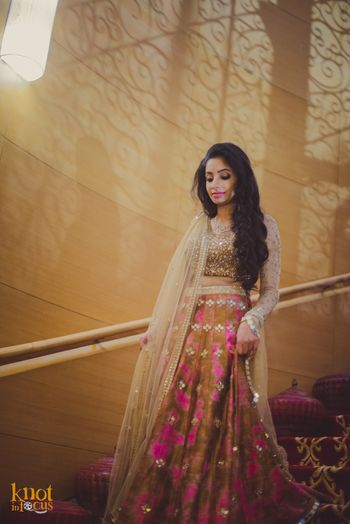 Pink and gold engagement lehenga by Akanksha Gajria