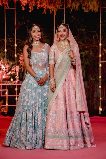bride with her sister wearing contrasting outfits