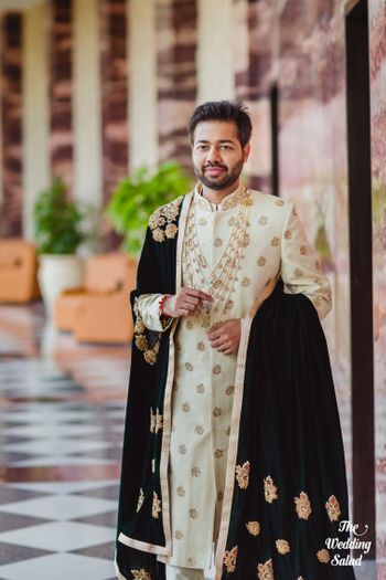Photo of Offwhite sherwani with black velvet dupatta