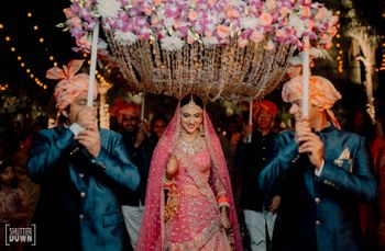 Pretty bridal entry under phoolon ki chaadar