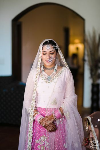 Minimal bridal lehenga with unique bridal jewellery
