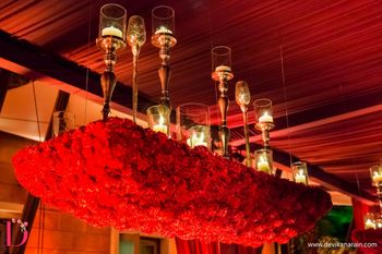 Photo of Red roses chandelier with candelabras
