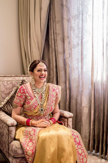 Fusion bride in yellow and red bridal saree