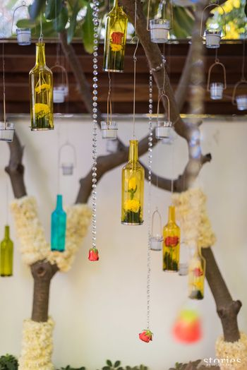 Suspended bottles with florals for haldi