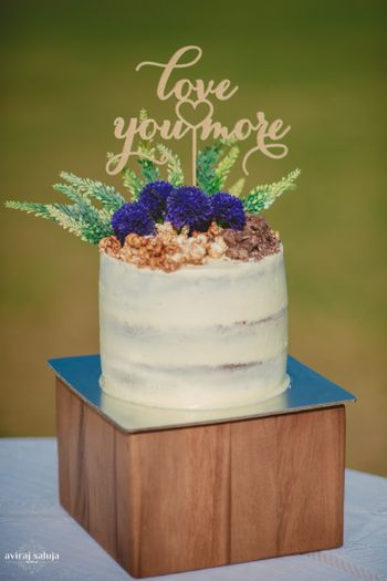 Wedding cakes with quote cake topper