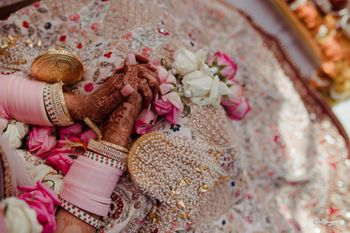 Photo of bridal hands with mehendi pastel choora and kaleere