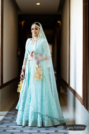 Pretty bride in light blue lehenga with sequin work