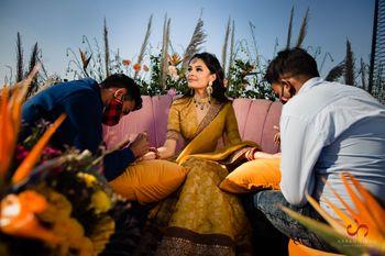 Bride on mehendi day in a Sabyasachi lehenga