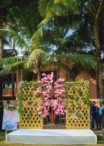 Photo of pink and gold and green outdoor small stage