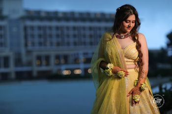 mehendi yellow lehenga with unique blouse design