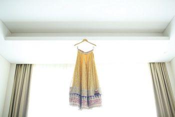 Photo of yellow lehenga with purple border by nova krishnan