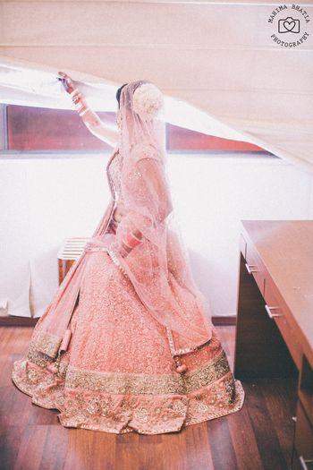 Pink threadwork lehenga and gold