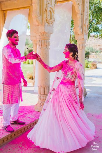 Photo of couple shot drenched in holi colours on their mehendi