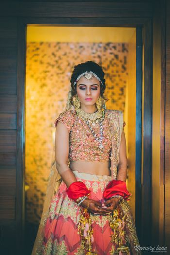 Photo of Peach bridal lehenga with gold