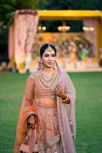 Photo of simple bridal look in offbeat peach lehenga