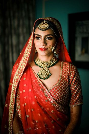 Contrasting jewellery with red lehenga and minimal look