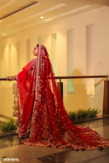 red bridal lehenga with a train for punjabi bride