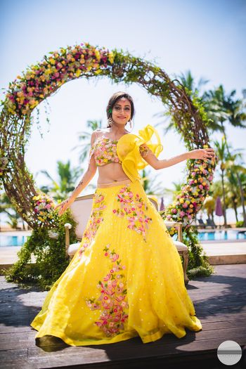 A bride to be in yellow lehenga