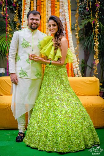 Photo of Unique mehendi lehenga with ruffled blouse