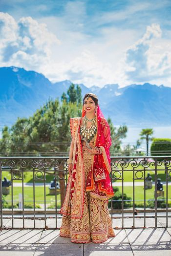 Photo of Bride in gorgeous red Abu Jani lehenga