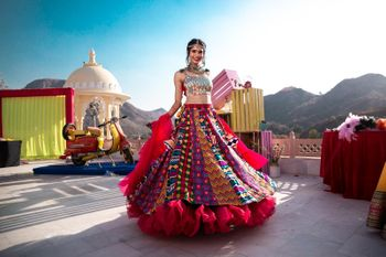 Bride twirling in a multicolor lehenga