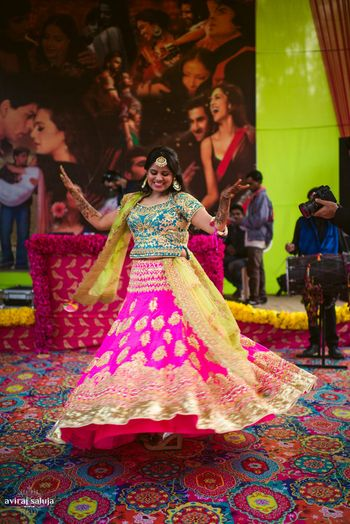 Photo of Fuschia pink lehenga in neon colors for mehendi