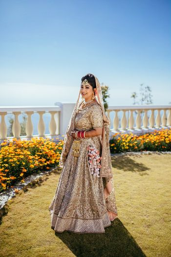 Photo of Pretty gold and beige lehenga with pom pom kaleere