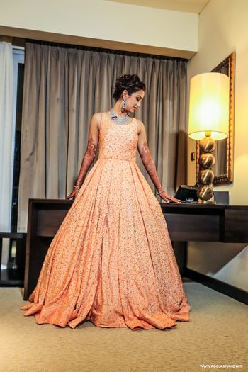 Peach floor length sleeveless voluminous full flare sparkly gown with sequin work