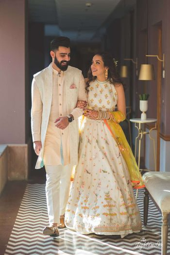 Photo of Mehendi bride and groom summery look in white