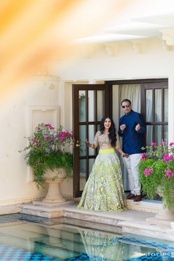 Light green mehendi lehenga worn by bride and father