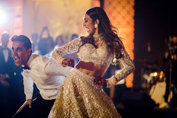 Bride and groom dancing at their reception ceremony.