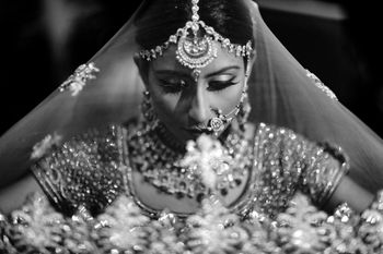 Classic bridal portrait in black and white with dupatta as veil