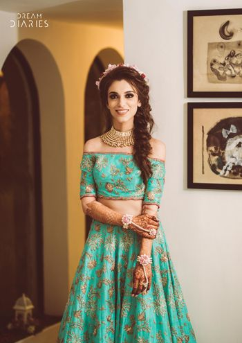 Turquoise lehenga with off shoulder for mehendi