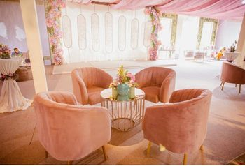 seating idea for wedding with pastel decor and sofas