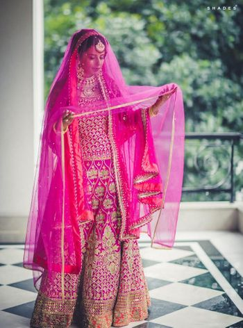 Photo of fuschia pink bridal outfit