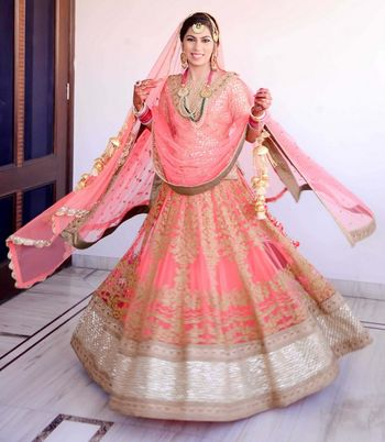 Photo of Pastel Pink Twirling Lehenga with Gold Border
